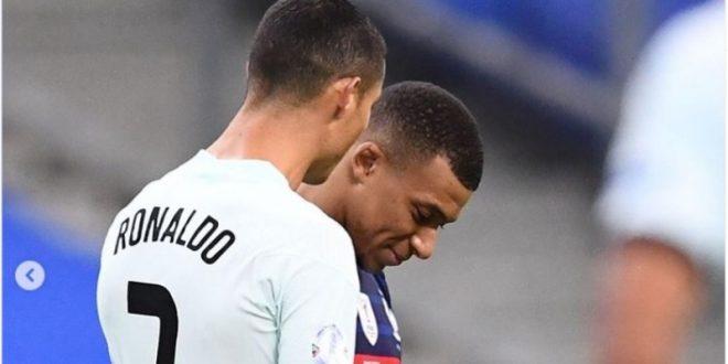 Фотографијата на Роналдо и Мбапе од тунелот после натпреварот е хит на интернет